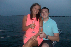 Couple enjoying champaign sunset cruise